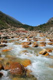 Flowing river in the rocky Riwuqie valley. Sichuan, China Stock Photos