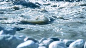 Flowing Stream. Cold flowing stream with blurred foreground stock video