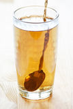 Flowing tea Stock Photo