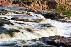 Flowing Water. Cascading water over sioux quartzsite rock formations Stock Image
