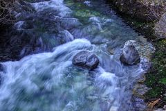 Flowing water captured with a slow shutter speed Stock Photos
