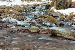 Flowing water of Carpathian mountain stream Royalty Free Stock Photography