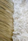 Flowing water cascading over a weir on yorkshire river Royalty Free Stock Photography