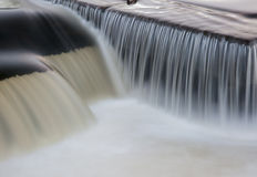 Flowing water cascading over a weir on yorkshire river Stock Photography