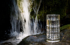 Flowing Water with Drinking Glass Royalty Free Stock Photo