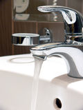 Flowing water faucet Stock Photography