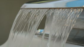 Flowing water from faucet stock video footage