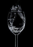 Flowing of water filling into Wine Glasses Stock Photos