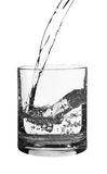 Flowing water in a glass Royalty Free Stock Image