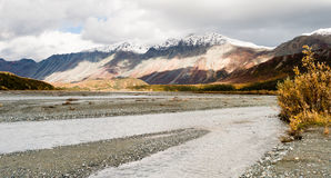 Flowing Water Gulkana River Flows by Alaska Range. Big water flows through the Alaska Range Stock Photography