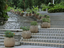 Flowing Water. Hong Kong July 2016 - A water feature with water flowing down stairs in the Hong Kong Park Royalty Free Stock Photo
