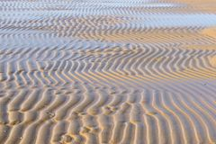 Flowing water at low tide. On the Italian coast of the Mediterranean Sea stock photography