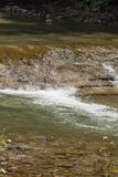 Flowing water in mountain swift river in the stones.  Royalty Free Stock Photography