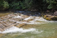 Flowing water in mountain swift river in the stones.  Stock Photography