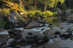 Flowing water over rocks and boulders Royalty Free Stock Image