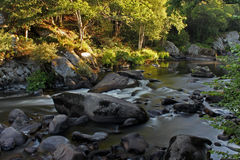 Flowing water over rocks and boulders Royalty Free Stock Photography