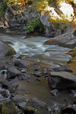 Flowing water over rocks and boulders Stock Image