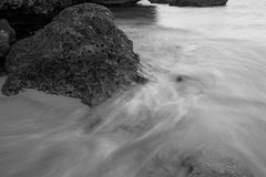 Flowing water over rocks Stock Photos