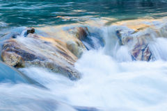 Flowing water. In a rapid river Royalty Free Stock Photography