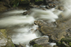 Flowing water river on rock.  Royalty Free Stock Image