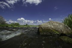 Flowing water. River Vantaa. Flowing water in river on very warm summer day Stock Image