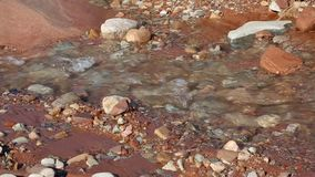 Flowing water and rock stock video footage