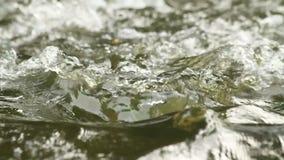 Flowing water, slowing stock video