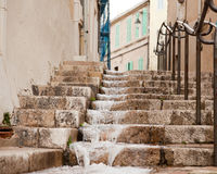 Flowing water on the steps in the old quarter of Marseille Stock Photos