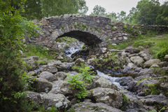 Flowing water with stone bridge Royalty Free Stock Photography