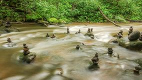 Flowing water and stones in river stock video