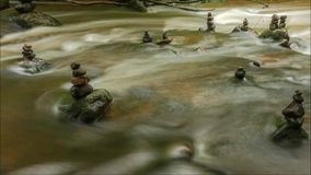 Flowing water through stones stock video footage