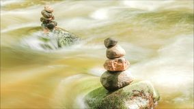 Flowing water through stones timelapse stock video footage
