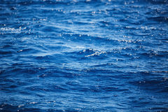 Flowing water surface.  Background of Carribean sea waves, near. Punta Cana, Dominican Republic Royalty Free Stock Photo