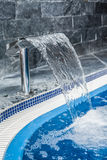 Flowing water in swimming pool Royalty Free Stock Photos