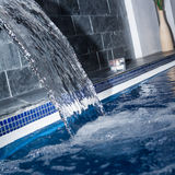 Flowing water in swimming pool Royalty Free Stock Photography