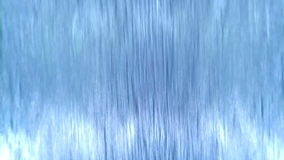 Flowing Water. Transparent clear water runs down a vertical surface stock footage