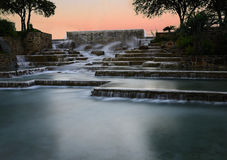 Flowing water at twilight. The Hemisphere plaza fountains in San Antonio Texas at twilight always flowing inviting tourism to the downtown area of the river city Royalty Free Stock Photos