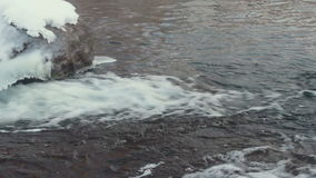 Flowing water. Water surface. Winter river. Fast river water. Stone with ice stock footage