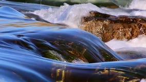 Flowing Water at the waterfall. Calm atmosphere, looping stock video footage