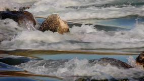 Flowing Water at the waterfall, looping. Flowing Water at the waterfall, calm atmosphere, looping stock footage