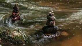 Flowing water through zen stones stock video
