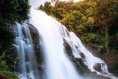 Flowing waterfall in mountain taken in low shutter speed stock photo