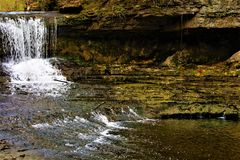 Flowing Waterfall In Ohio. A rapidly flowing waterfall in beautiful Yellow Springs, Ohio Royalty Free Stock Photo