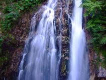 Flowing waterfall Stock Images