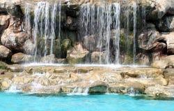 Flowing waterfall swimming pool. Flowing waterfall in swimming pool Royalty Free Stock Image