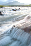 Flowing waters of a River. Low angle picture of flowing waters of the Tugela River in Northern Drakensberg in South Africa. The picture was taken during last Stock Photo