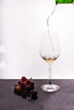 Flowing wine on white background and grape Stock Photography