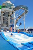 Flowrider Surf Simulator and Waterslides on sports deck, Royal Caribbean. Flowrider Surf Simulator onboard Liberty of the Seas cruise ship, Royal Caribbean stock photo
