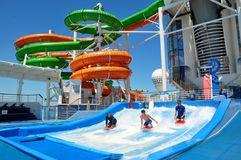 Flowrider Surf Simulator and Waterslides on sports deck, Royal Caribbean. Flowrider Surf Simulator onboard Liberty of the Seas cruise ship, Royal Caribbean stock images