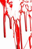 Close up of red paint. Flows of red glossy paint close-up on white background royalty free stock image